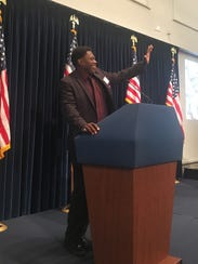 Dmitri Young waves to the crowd during his county hall