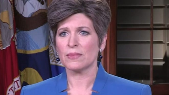 Sen. Joni Ernst, R-Ia., delivers the Republican response to the State of the Union address Tuesday night from Washington.