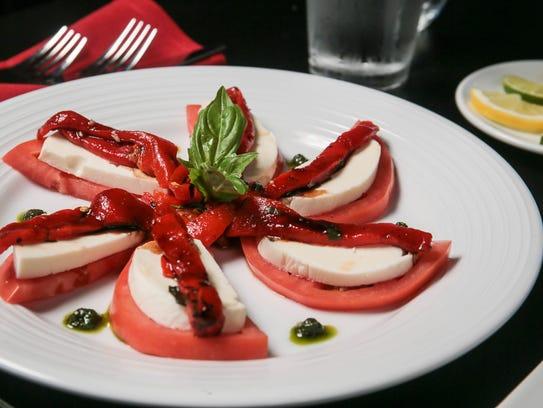 Caprese Salad - House-made Mozzarella, Vine Ripe Tomato, Balsamic, Roasted Peppers, Pesto Oil, and Basil, at Nunzio's Dolce Vita, 90 South Street, Morristown.
