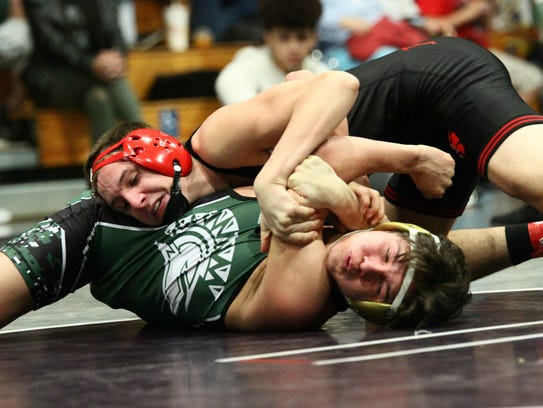 Foothill High's Russell Rucklos, top, competes against