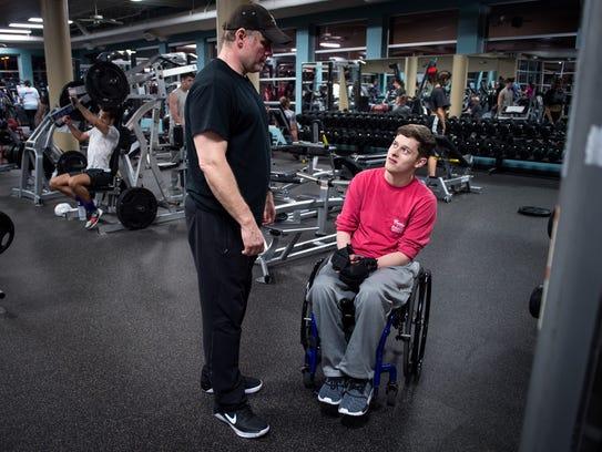 Hunter Garstin speaks with his trainer Mark Davenport
