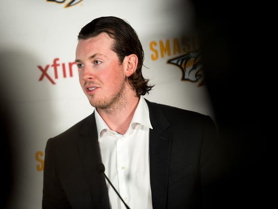 Ryan Johansen speaks during a press conference at Bridgestone
