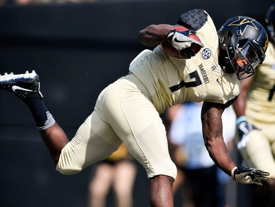 Vanderbilt running back Ralph Webb (7) leaps in for