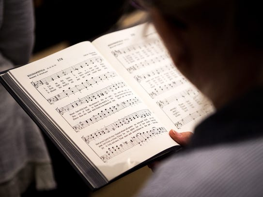 Congregants sing hymns during a service at the Nashville