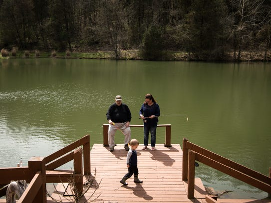 Ben Jumper and his wife, Katie Jumper, fish with their grandson Emerson, 3.