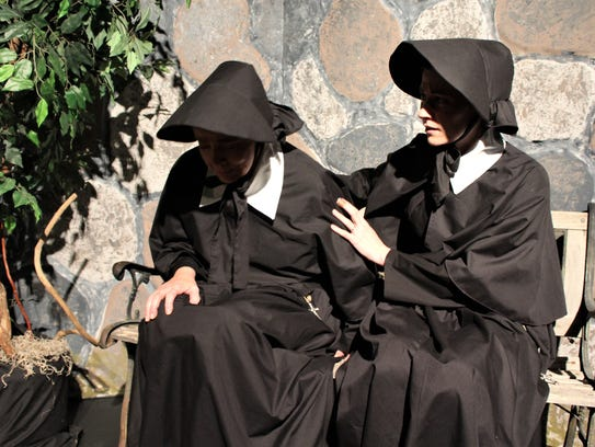 Principal Sister Aloysius (Elise Pryor-Harden) is comforted