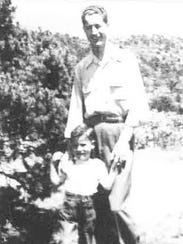 A young Ken and his father, Vernon.