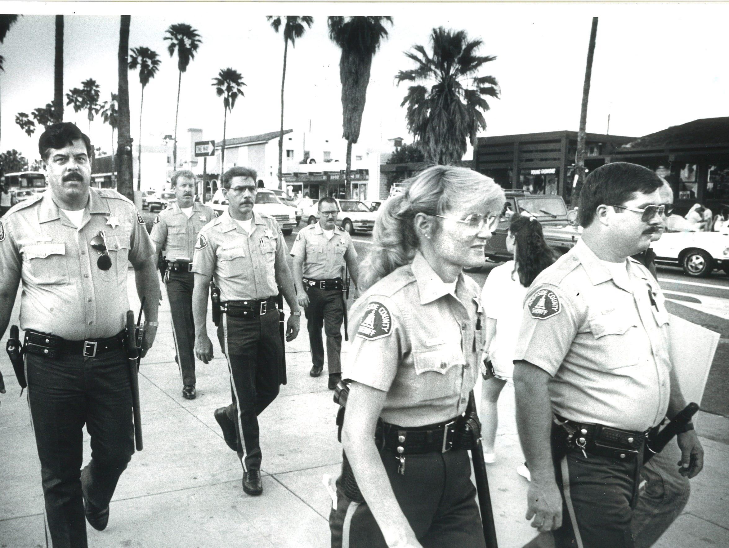 Riverside County sheriff's deputies patrol the streets