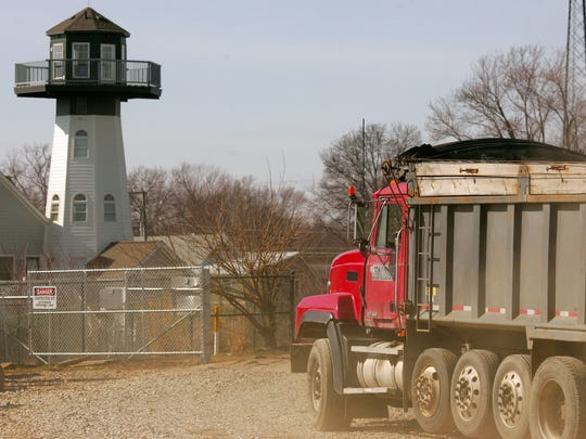 A dump truck leaves North Shore Park Tuesday in Buckeye Lake. Truck traffic is expected to lighten after the embankment stability berm is fully completed, projected mid-March.