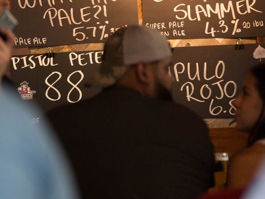 """The new """"Pistol Pete's 1888 Ale"""" a beer brewed by Bosque Brewing Co. in conjunction with the NMSU. The beer is on tap at Bosque Brewings taproom and will be available in cans in early 2018. Thursday Aug. 17, 2017."""