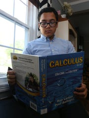 Tyler Manrique browses an advanced placement calculus