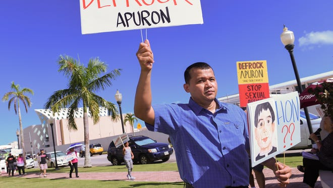 Apuron accuser Roy Quintanilla participates in a protest held at Dulce Nombre de Cathedral Basilica in Hagatna on July 31.
