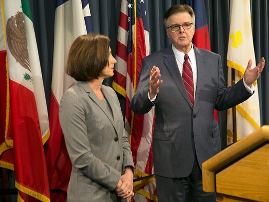"""FILE - In this Jan. 5, 2017, file photo, Texas Lt. Gov. Dan Patrick and state Sen. Lois Kolkhorst discuss Senate Bill 6, known as the Texas Privacy Act, which would require transgender people to use bathrooms corresponding to their sex at birth.  The NBA has warned that Texas could be overlooked for future events because of the proposed """"bathroom bill.""""  The Texas legislation is similar to a North Carolina law that prompted the league to move the All-Star Game out of that state. NBA spokesman Mike Bass says an environment where people are treated """"fairly and equally"""" weighs heavily in deciding host locations. The NBA first made the statement last week, and the NFL has issued similar warnings. (Ralph Barrera/Austin American-Statesman via AP)"""