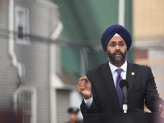 New Jersey Attorney General Gurbir Grewal announces lawsuits focused on contaminated properties during a press conference in Newark on Wednesday.