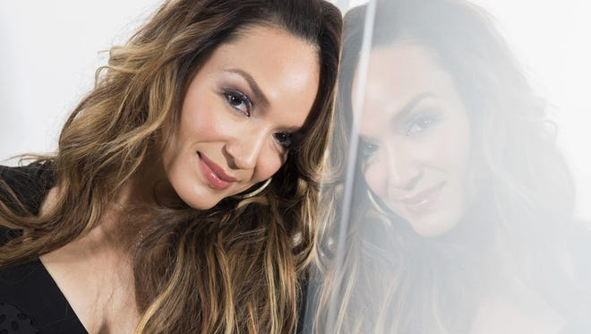 """Mayte Garcia, the first wife of the late pop singer Prince, says she wrote a book about their relationship, """"for love."""""""
