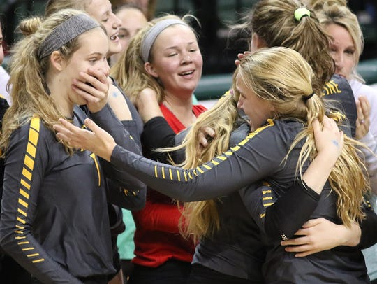 Ursuline Academy Lions celebrate after winning the