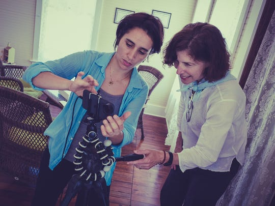 """Marilu Holmes and Wendy White set up their iPhone 6s to film the next scene of """"Thinking Out Loud."""" The short movie was shot entirely with the cell phone."""