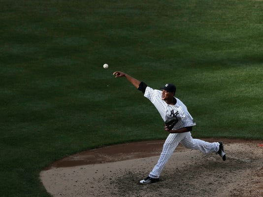 New York Yankees starting pitcher Ivan Nova delivers to a San Francisco Giants batter during the fifth inning of a baseball game Saturday, July 23, 2016, in New York. (AP Photo/Julie Jacobson)