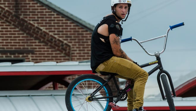 Muncie native Michael Teal, a BMX rider with Solution Action Sports, prepares to perform a stunt during a show at the Indiana State Fair in Indianapolis on Wednesday, Aug. 10, 2016.