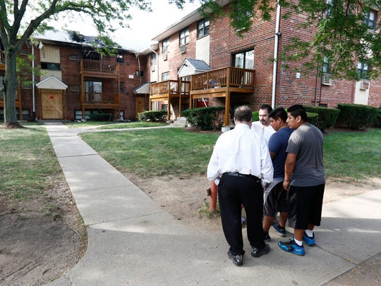 Complex residents gather in the courtyard after fire
