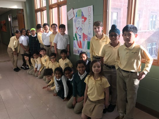 Fourth Graders show off their art work in the hall