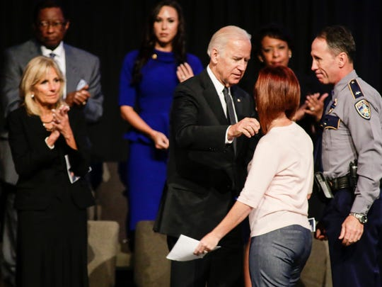 Dechia Gerald, wife of officer Matthew Gerald-  one of three Baton Rouge law enforcement officers killed in a July 17 shootout, is consoled by Vice President Joe Biden at a memorial honoring the men in Baton Rouge July 25.