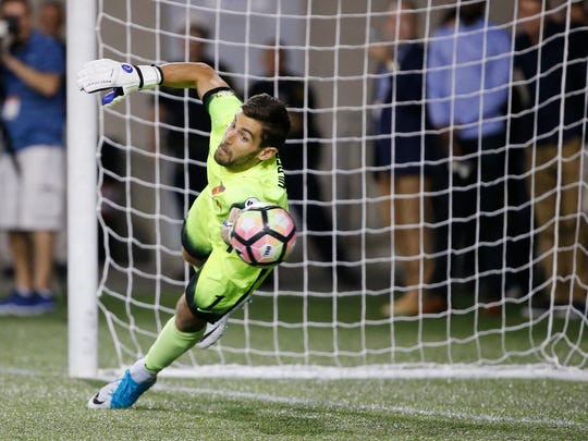 FC Cincinnati goalkeeper Mitch Hildebrandt (1) saves the penalty shot to win the game penalty kicks during the Lamar Hunt US Open Cup match between the Chicago Fire and FC Cincinnati on June 28, 2017 at Nippert Stadium.