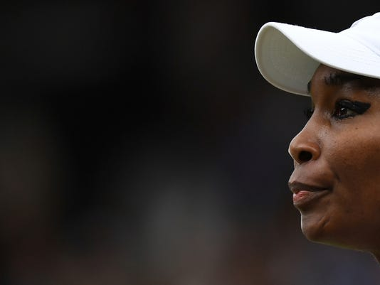 Venus Williams of the United States pauses between points as she plays Spain's Garbine Muguruza in the Women's Singles final match on day twelve at the Wimbledon Tennis Championships in London Saturday, July 15, 2017. (David Ramos/Pool Photo via AP)