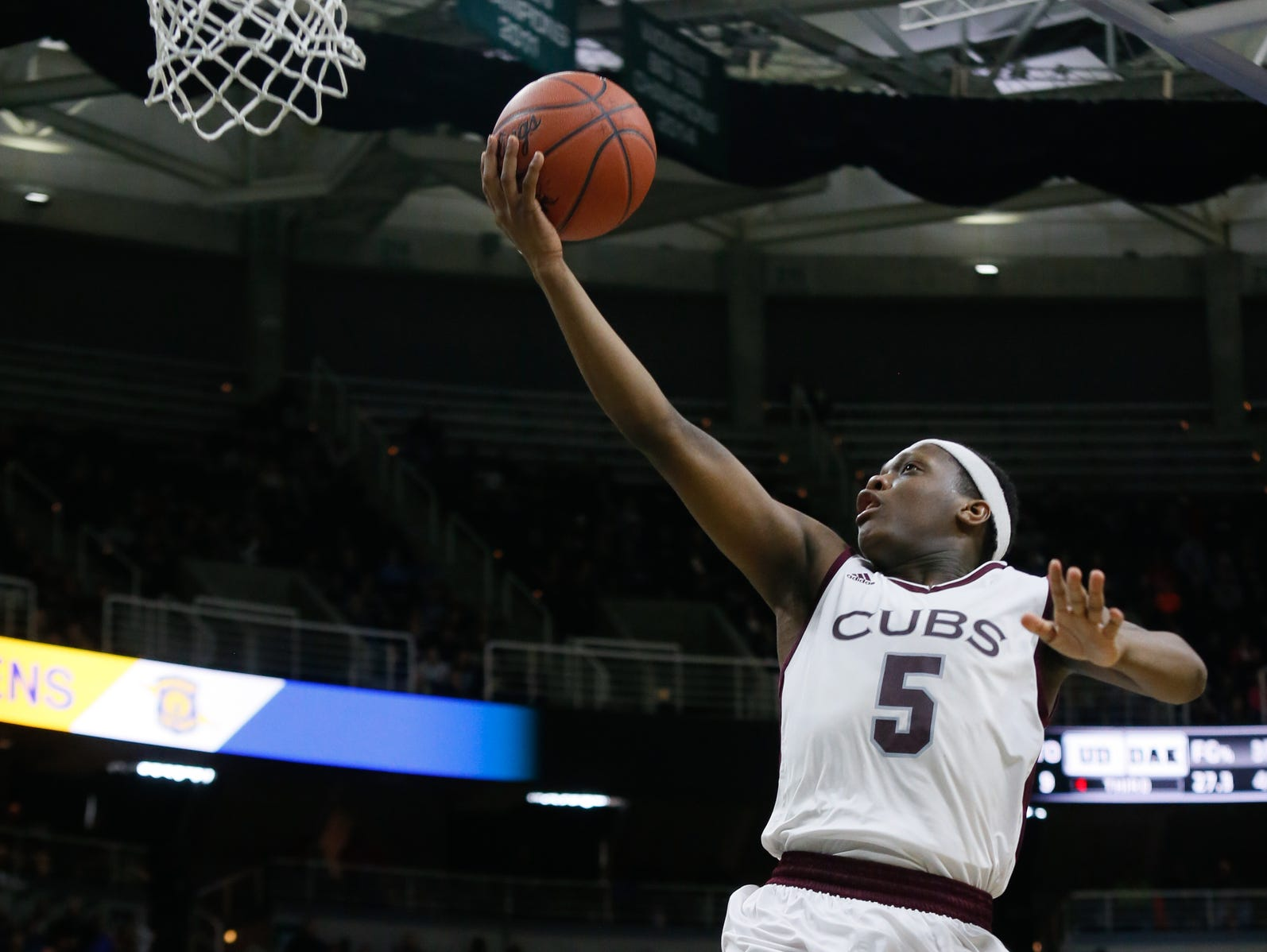 U-D Jesuit's Cassius Winston makes a lay-up against Macomb Dakota during an MHSAA boys basketball Class A semifinal Friday, March 25, 2016, in East Lansing. U-D won, 72-51.
