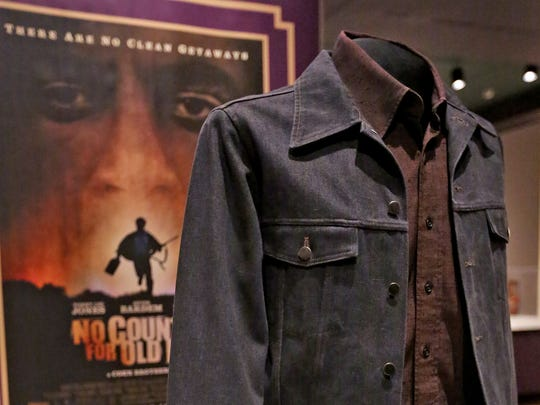"""This is the full costume worn by Javier Bardem, as Anton Chigurh, in """"No Country for Old Men,"""" (a Miramax Films 2007 movie), seen here in The Reel West exhibit at the Eiteljorg Museum, Thursday, March 1, 2018.  The exhibit, which runs Mar. 3, 2018 to Feb. 3, 2019, looks at """"morality, diversity, and American identity,"""" seen through the Western film genre, Hollywood movies, and television shows."""