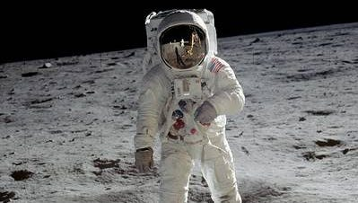 Astronaut Buzz Aldrin walks on the surface of the moon during the Apollo 11 mission. Mission commander Neil Armstrong took this photograph with a 70-mm lunar surface camera.