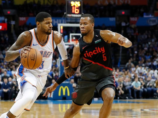 Portland acquired Rodney Hood, right, from Cleveland.