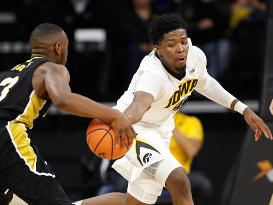 Iowa guard Isaiah Moss (right) tries to steal the ball from Alabama State guard Gene Davis during the first half Sunday at Carver-Hawkeye Arena. Moss and the Hawkeyes dominated the Hornets to move to 2-0 on the season.