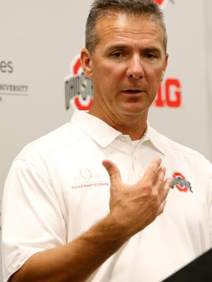 Ohio State football coach Urban Meyer speaks to reporters Aug. 16, 2015.