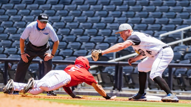 Amarillo Sod Squad's Max Marusak (left), an Amarillo High graduate, dives back into first base after a pickoff throw under the tag of Texarkana first baseman Reed Spenrath in Saturday's Texas Collegiate League game at Hodgetown. The two teams resume their series today at Hodgetown for the next three days.