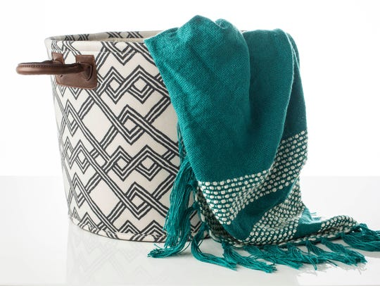 Store: Use a canvas basket to keep extra linens, towels,
