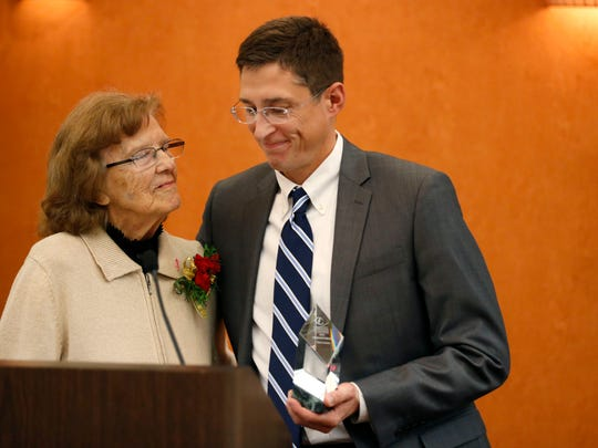 Kurt Larson, who founded Safe and Sober in 2004, thanks Jewell Schweitzer after being named the Community Foundation of the Ozarks' Humanitarian of the Year during a luncheon on Tuesday, Dec. 8, 2015.