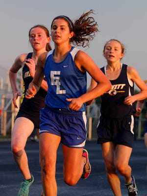 East Lansing's Stephanie Vanis, center, competes in the 3200 meter run during the Honor Roll track meet Tuesday, May 26, 2015, at Holt High School.