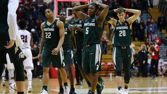 The Michigan State Spartans react after defeating the Indiana Hoosiers at Assembly Hall.
