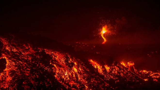 A photo taken on Tuesday, Feb. 28, 2017 shows Mount Etna erupting near the Sicilian town of Catania, southern Italy.
