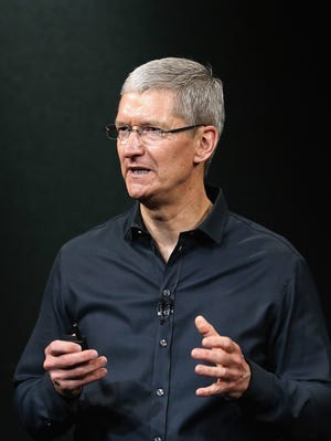 Apple CEO Tim Cook speaks during an Apple product announcement at the Apple campus on Sept. 10, 2013, in Cupertino, Calif.