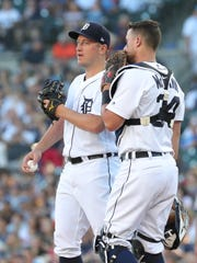 Detroit Tigers catcher James McCann and pitcher Jordan Zimmermann talk on the mound during third inning action against the Texas Rangers Friday, July 6, 2018, at Comerica Park in Detroit.