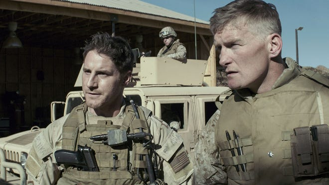 """New Rochelle's Chance Kelly, right, plays Lt. Col. Jones in this scene from Clint Eastwood's American Sniper."""" The film was just nominated for six Academy Awards."""