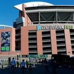 CenturyLink Field is shown with the Seattle Seahawks upcoming NFL football schedule posted on the outside, Saturday, June 13, 2015, in Seattle. (AP Photo/Ted S. Warren)