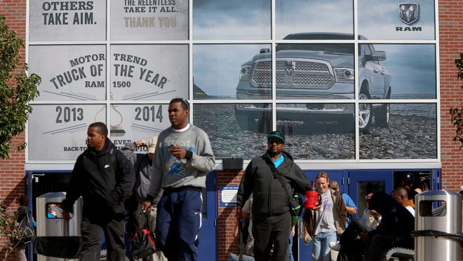 During the 3:30 pm shift change at the FCA Warren Truck Assembly Plant on Mound Road in Warren, Michigan workers head out towards their employee parking lot across the street on Thursday, October 1 2015. Nearby their union representatives were working with FCA on a contract.