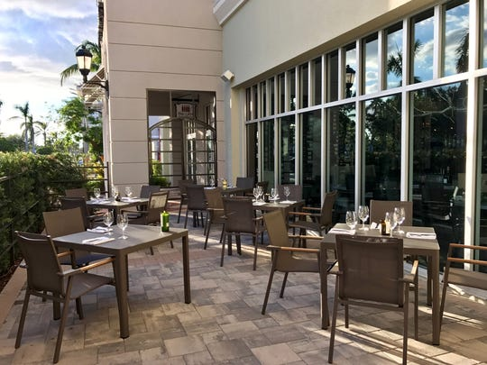 The patio at The Cave Bistro & Wine Bar, an extension of Naples Wine Collection in the Galleria Shoppes at Vanderbilt on the northwest corner of Airport-Pulling and Vanderbilt Beach roads.