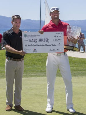 ACC Golf Tournament winner Mark Mulder, right, receives his check from Jonathan Thomas, American Century President & CEO at Edgewood on Sunday July 24, 2016.