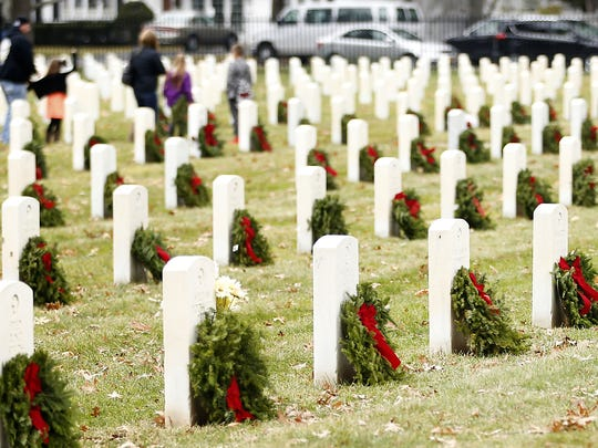 More than 1,200 wreaths adorn Woodlawn National Cemetery
