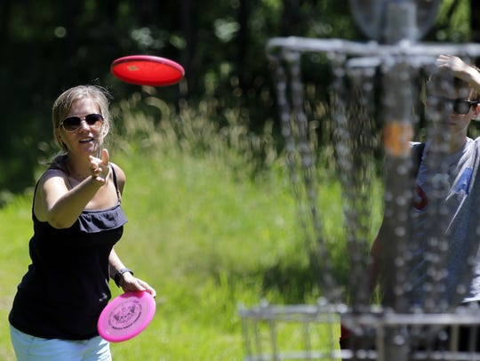 Heidi Davies plays disc golf Sunday with her son, Blake,