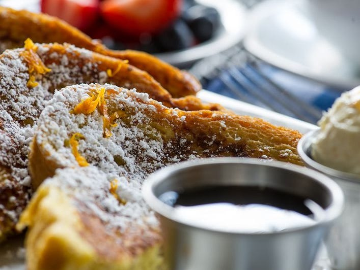 Celebrated during his 14-year tenure at Peninsula Grill, chef Robert Carter has crafted a menu of classic American dishes, like this French toast served with butter and maple syrup.